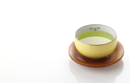 Japanese green tea in porcelain cup on white background