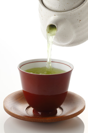 japanese green tea: Japanese green tea in porcelain cup and tea pot on whit background