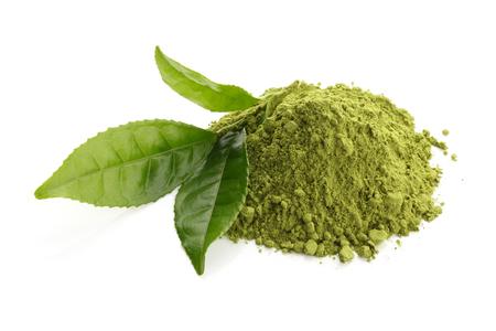 Matcha groene thee poeder en verse groene theebladeren Stockfoto - 46190839