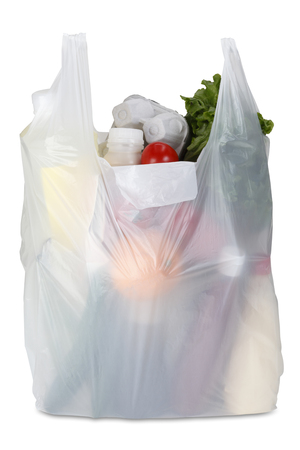 plastic waste: White plastic bag on the white background. Clipping path included.
