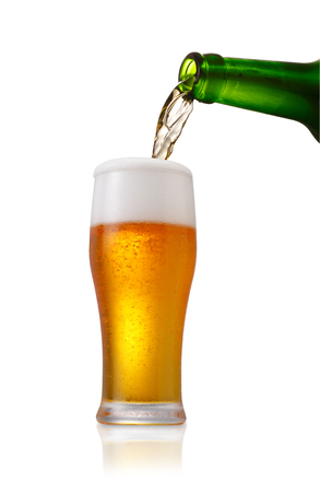 single beer bottle: Beer pouring into glass on a white background Stock Photo