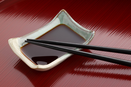 soy sauce: Chopsticks and soy sauce dish on tray of the lacquering Stock Photo