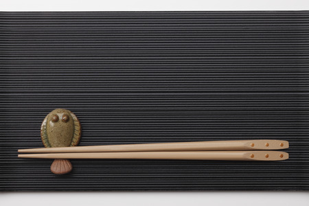 directly above: Chopsticks on black lacquering plate