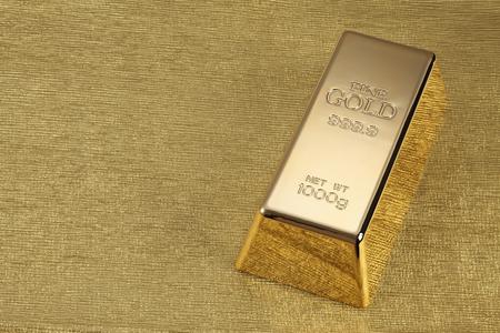ゴールドの背景に金 1 kg バーの写真