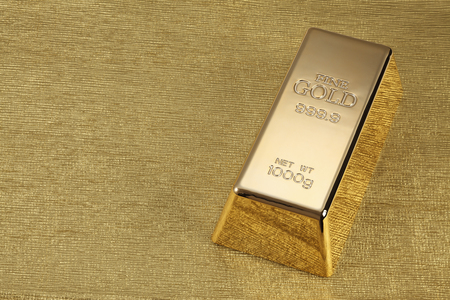 barra: Foto de una barra de 1 kg de oro sobre fondo de oro