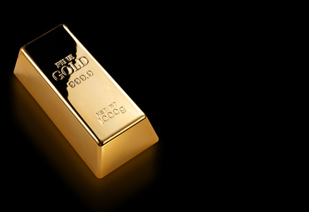 gold bar: Photo of a 1kg gold bar isolated on a black background Stock Photo