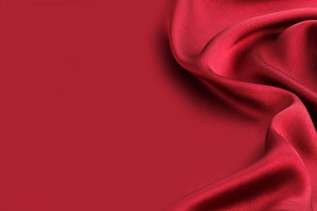 Red silk textile background Imagens