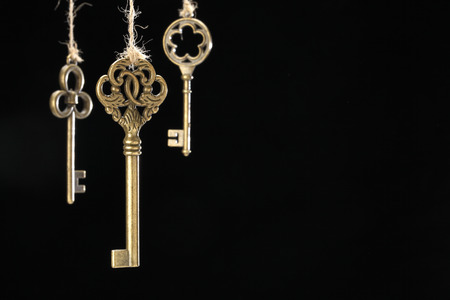Antique golden keys on black
