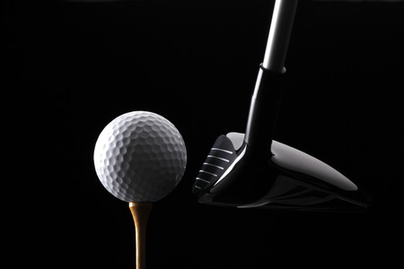 Golf ball club and tee on black background Imagens