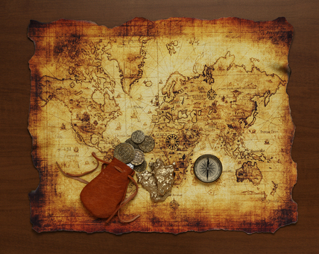 charred: old compass on vintage map. Stock Photo