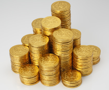 coins shot in golden color: Closeup shot of Golden Coins on Gold  chocolate Coin Stock Photo
