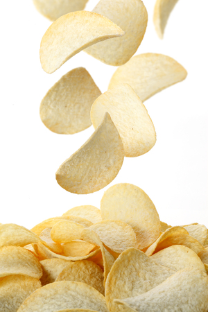 potatoes: Pile of potato chips in isolated white background