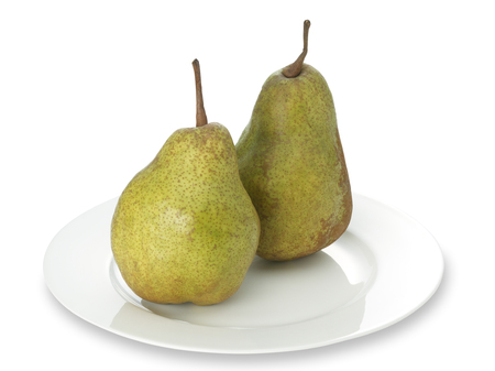 anjou: Green anjou pear on a white plate with clipping path Stock Photo