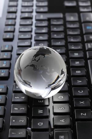glass globe: Glass Globe and Computer Keyboard