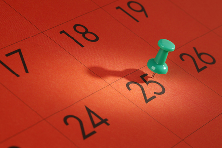 decembe: Christmas Day Concept.Green Push-pin in 25th Decembe Stock Photo
