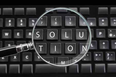 discovery: SOLUTION written on keyboard with magnifying glass