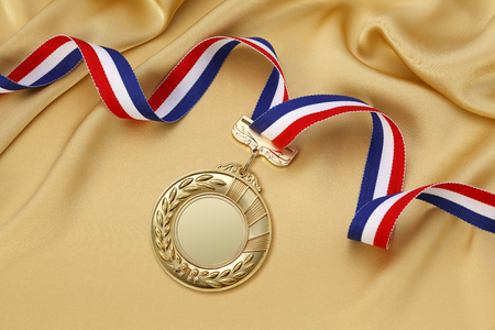 blue and gold: Gold medal on a gold satin background Stock Photo