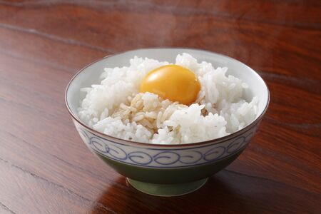 Raw Egg over Rice Stock Photo