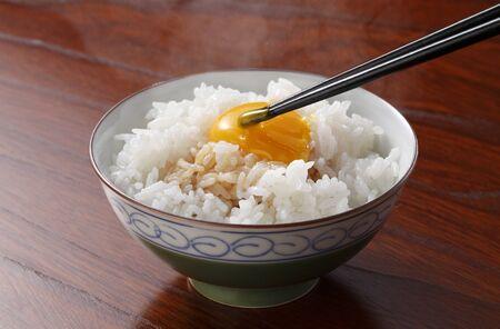 white rice: Raw Egg over Rice Stock Photo
