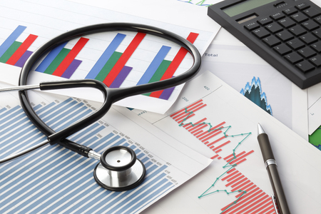 financial statement: Stethoscope with financial statement Stock Photo