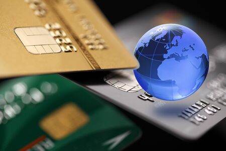 Internet Banking. Credit card with Globe. Payment concept.