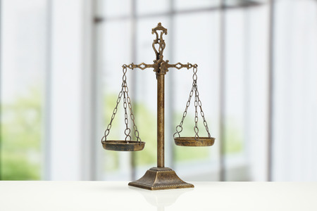 lawsuit: Justice Scale on white background Stock Photo