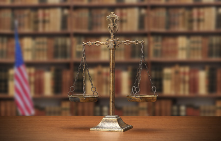 antique books: Justice Scale on wood table