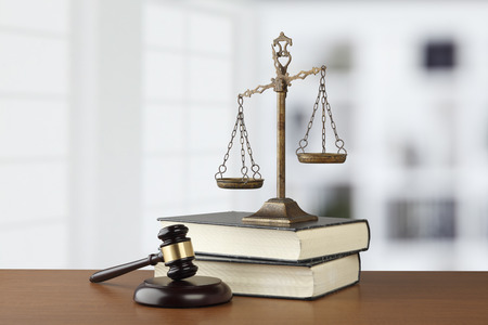 Judges Gavel And Scale Of Justice On The Table Stock fotó