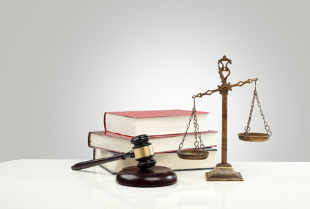 ruling: Gavel And Scales Of Justice and Law Books On Desk