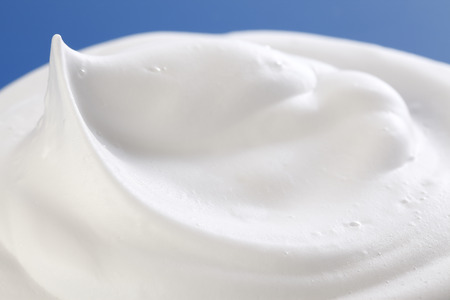 Shaving cream on Blue Standard-Bild