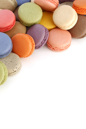 Sweet and colorful macaroons or macaron on white background,