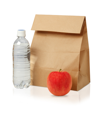 apple paper bag: Lunch time. Closeup of Brown paper lunch bag, red apple and bottle of water isolated on white...