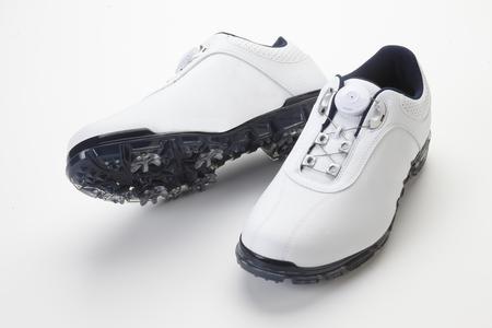 Golf shoe Standard-Bild