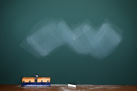 chalk eraser: Greenboardchalkboard texture. With eraser and chalk traces