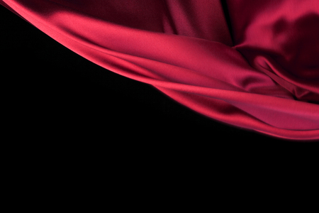 red cloth: Red Fabric Cloth Flowing on Wind, Textile Wave Flying In Motion. Isolated on Black background Stock Photo