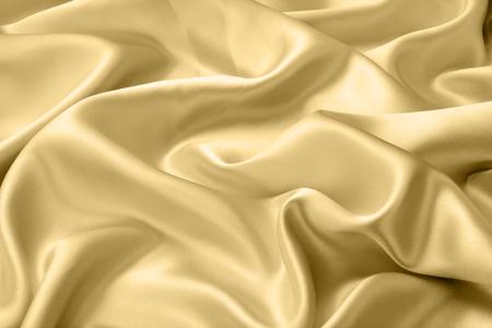 Oro satinato o tessuto di seta come sfondo Archivio Fotografico - 65872317