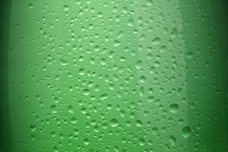 A large green glass bottle filled with carbonated water Stock Photo