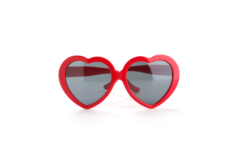 Red heart-shaped sunglasses isolated on white Stock Photo