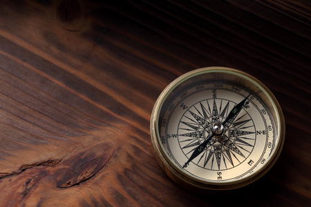 old compass on wood background
