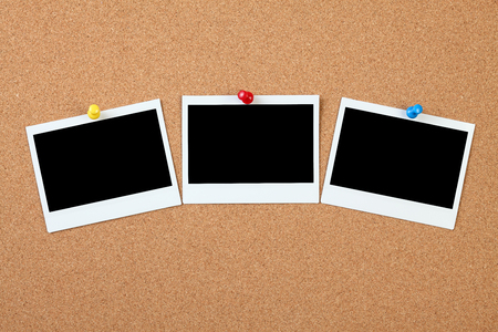 Blank instant photo on a cork board Stock Photo