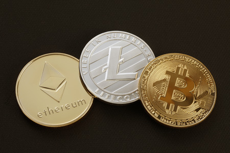 Studio shot of Gold etereum litecoins, Bitcoin on black background. Digital virtual currency Imagens