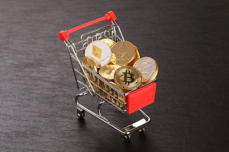 Bitcoins and New Virtual money concept.shopping carts full of Gold bitcoins with dark background