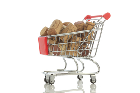 Shopping Cart Filled with Corks, Isolated On White Background Stockfoto