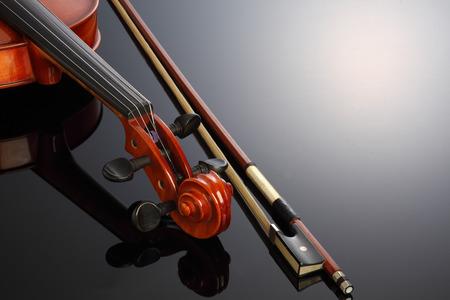 A violin on a dark background.