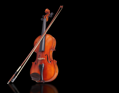 Violin with bow isolated on black background