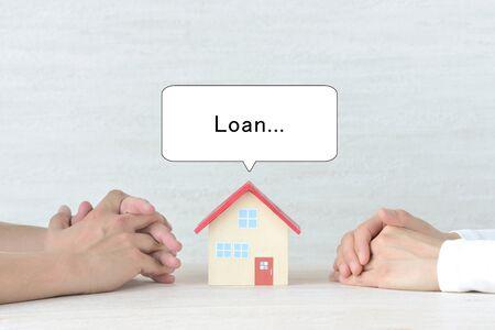 Couple talking about housing loan 写真素材