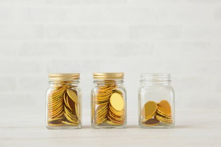Savings and Savings Image - Gold Coins in Bottles