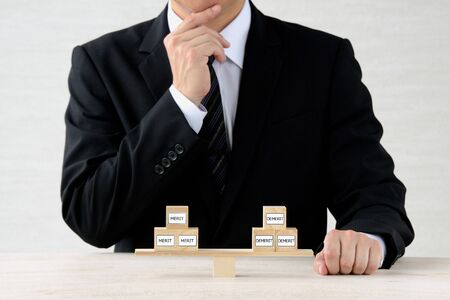 Businessmen considering the balance between advantages and disadvantages