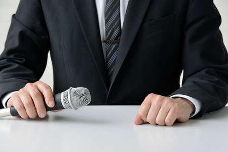 a businessman who uses a microphone