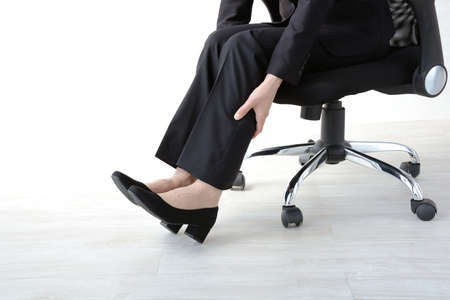 Businesswoman with sore feet
